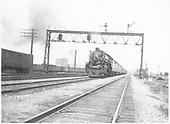 Santa Fe Pacific #3417 approaching with a passenger train on the outskirts of Chicago.<br /> AT&amp;SF  Chicago, IL  1931