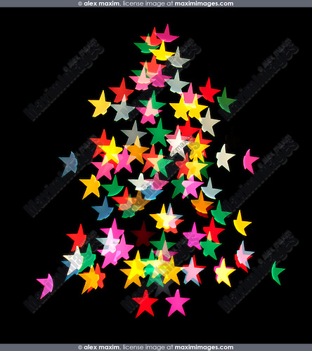 Shining star shaped Christmas tree lights isolated pattern on black background