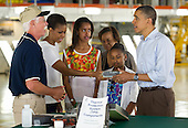 Terry White, United Space Alliance project lead for thermal protection systems, left, shows United States President Barack Obama and his family, from left, First Lady Michelle Obama, Malia, Marian Robinson and Sasha, how tiles work on the space shuttle during their visit to the Orbital Processing Facility at the NASA Kennedy Space Center in Cape Canaveral, Florida, Friday, April 29, 2011. .Mandatory Credit: Bill Ingalls / NASA via CNP
