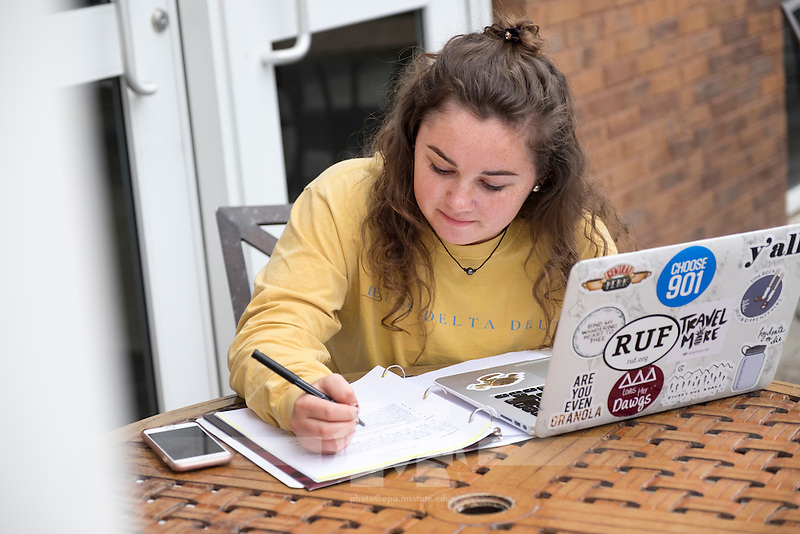 Student Ambassador Sara Beth Pritchard works on her postcards to incoming students on the Colvard Union patio.<br />  (photo by Megan Bean / &copy; Mississippi State University)
