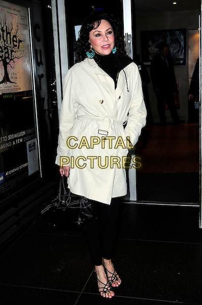 MARIE HELVIN.An Academy Tribute To Jeremy Thomas,.Curzon Soho,Shaftesbury Avenue, London, England..November 25th 2010.full length black trousers grey gray mac coat jacket scarf hand in pocket sandals toes feet.CAP/CAS.©Bob Cass/Capital Pictures.