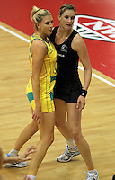 09.06.2011 Silver Ferns Leanna de Bruin and Diamonds Catherine Cox in action during the netball match between the Silver Ferns and Australia held at Arena Manuwau in Palmerston North. Mandatory Photo Credit ©Michael Bradley.