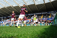 Matt Grimes of Swansea City during the pre-match warm-up for the Sky Bet Championship match between Swansea City and Rotherham United at the Liberty Stadium in Swansea, Wales, UK.  Friday 19 April 2019