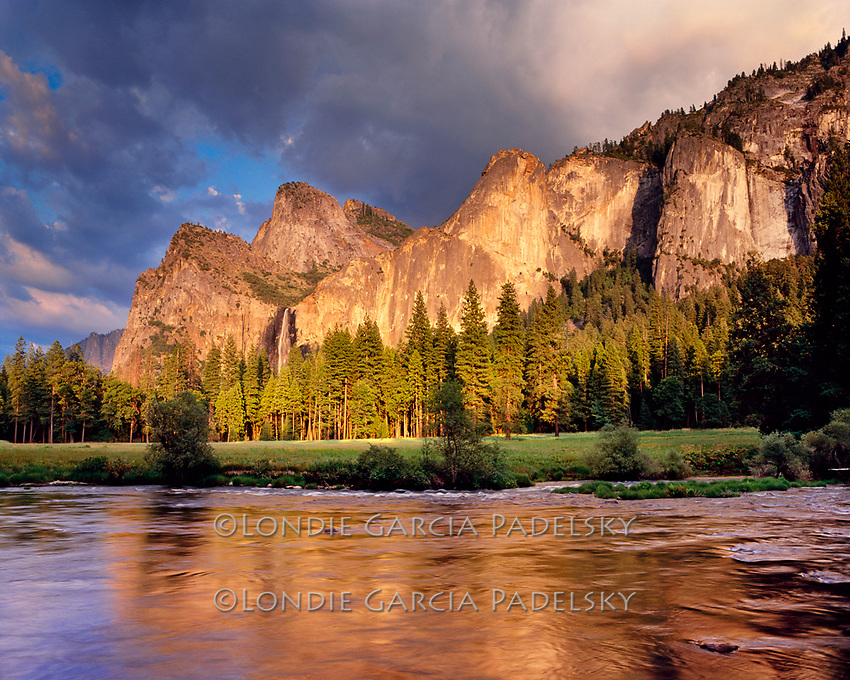 Cathdral Peaks and Bridalveil Fall reflect into the Merced River, .Yosemite National Park, California