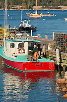 Lobster fisherman working on his boat, Manset, Maine, Me, USA
