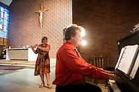 "Musicians Duane Sullivan (right) and Pamela Nichols, both of Belmont, Mass., prepare hymns for the service at St. Frances Xavier Cabrini Church in Scituate, Mass., on Sun., May 29, 2016. Members of the congregation have been holding a vigil for more than 11 years after the Archdiocese of Boston ordered the parish closed in 2004. For 4234 days, at least one member of Friends of St. Frances X. Cabrini has been at the church at all times, preventing the closure of the church. May 29, 2016, was the last service held at the church after members finally agreed to leave the building after the US Supreme Court decided not to hear their appeal to earlier an Massachusetts court ruling stating that they must leave. The last service was called a ""transitional mass"" and was the first sanctioned mass performed at the church since the vigil began."