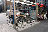 "New York, NY 8 April 2008 - Union Square Bicycle Shelter. The shelters accomodate eight bikes and were created by Cemusa, a Spanish design firm that is also building bus shelters and public toilets for the City. Each bike shelter features an enlarged Ne York City Cycling Map and ""Look"" Bicycle Safety Campaign posters"
