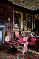 The drawing room walls are full of family and royal portraits, while numerous pieces of antique furniture have been placed around the spacious room