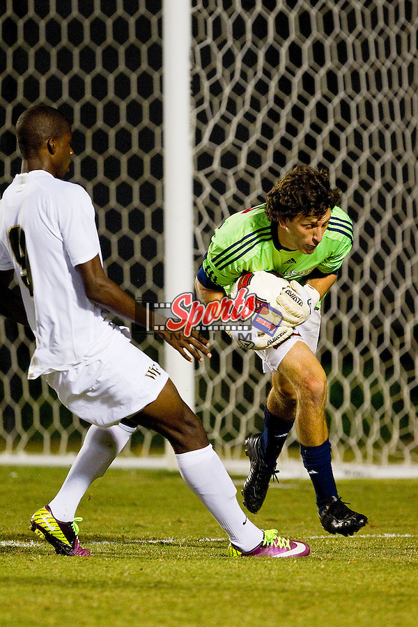 Ben Gold #23 of the Davidson Wildcats collects the ball in front of Sean Okoli #9 late in the second half of play at Spry Soccer Stadium on September 28, 2011 in Winston-Salem, North Carolina.  The Demon Deacons defeated the Wildcats 4-1.  (Brian Westerholt / Sports On Film)