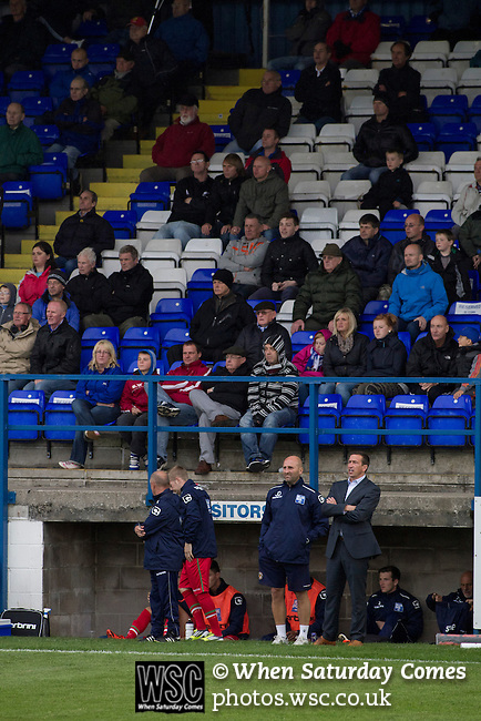 Barrow AFC 0 Newport County 3, 15/09/2012. Furness Building Society Stadium, Football Conference. Visiting manager Justin Edinburgh (in suit) watching the action from the dugout at Barrow AFC's Furness Building Society Stadium during the Barrow (white shirts) v Newport County Conference National Fixture. Newport County eventually won the match by 3-0, watched by 802 spectators. Both Barrow and Newport County from Wales were former members of the Football League in England. Photo by Colin McPherson.