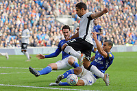 Wayne Routledge of Swansea City (C) is stopped by Sean Morrison (L) and Lee Peltier of Cardiff City (R) during the Sky Bet Championship match between Cardiff City and Swansea City at the Cardiff City Stadium, Cardiff, Wales, UK. Sunday 12 January 2020