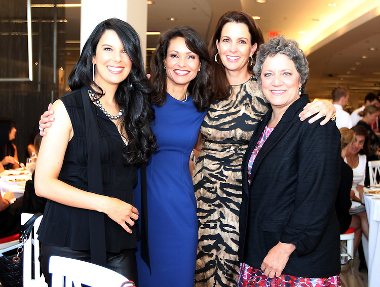 BOSTON -- From left, Linda Pizzuti Henry, wife of Boston Red Sox principal owner John Henry, Liz Brunner of WCVB, Stacey Lucchino, wife of Red Sox president and CEO Larry Lucchino, and Meg Vaillancourt, executive director of the Red Sox Foundation, attend the From Fenway to the Runway charity fashion show benefitting the Red Sox Foundation at Saks Fifth Avenue on Thursday, Sept. 13, 2012. (Brita Meng Outzen/Boston Red Sox)