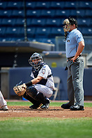 Staten Island Yankees catcher Jackson Thoreson (35) looks into the dugout in front of home plate umpire Jordan Sandberg during a game against the Lowell Spinners on August 22, 2018 at Richmond County Bank Ballpark in Staten Island, New York.  Staten Island defeated Lowell 10-4.  (Mike Janes/Four Seam Images)