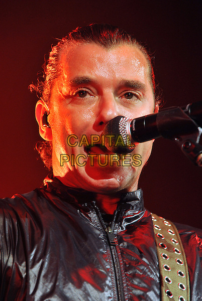 """BUSH.Vocalist/guitarist GAVIN ROSSDALE of the British rock band BUSH performs on a stop on their """"2001 U.S. Reunion Tour"""" held at the Stage AE, Pittsburgh, PA, USA.       .October 10th, 2011   .performing performance on stage in concert live gig music headshot portrait black leather sweat sweating singing.CAP/ADM/JN.©Jason L Nelson/AdMedia/Capital Pictures."""