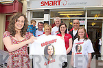 FAME contestant Caoimhe Garvey Tralee picks up her T-Shirts in Smart Designs Killarney on Saturday morning l-r: Paul, Keelan, Odhran O'Shea, Paddy, David, Teresa Smart, Aoife and Maria Garvey