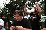 Debbie Dirks rallys support from the crowd for Stover Harger during the crawfish eating contest..