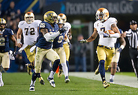 TJ Jones (7) breaks free on a big run in the first quarter as Pittsburgh Panthers safety Jason Hendricks (25) pursues.