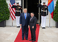 President Khaltmaa Battulga of Mongolia, right, waves to the press as he and United States President Donald J. Trump, left, participate in the arrival at the South Portico of the White House in Washington, DC on Wednesday, July 31, 2019. Photo Credit: Ron Sachs/CNP/AdMedia