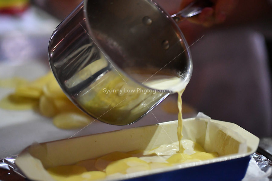 Melbourne, 30 May 2017 - Andrew Ballard of the Simmer Culinary in Mornington pours cream onto potatoes at the Australian selection trials of the Bocuse d'Or culinary competition held during the Food Service Australia show at the Royal Exhibition Building in Melbourne, Australia. Photo Sydney Low