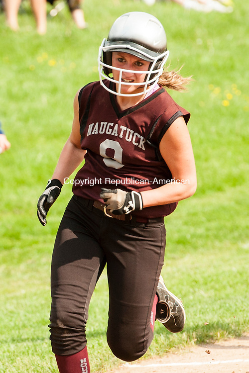WATERBURY, CT-27 May 2014-052714EC01-  Action man. Erica Andreoli heads home, scoring a run against Holy Cross. Naugatuck defeated the Crusaders, 6-3, in the NVL softball quarterfinals Tuesday in Waterbury. Erin Covey Republican-American
