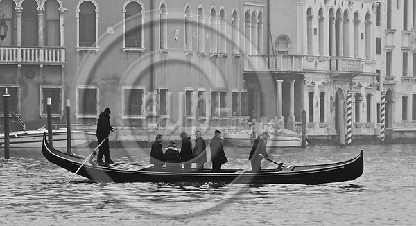 Venice-Italy - January 09, 2011 -- Traghetto gondole, public transfer - transport service to cross Grand Canal / Canal Grande on a gondola -- infrastructure, transport, water, b&w -- Photo: Horst Wagner / eup-images