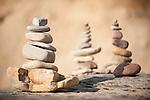 La Jolla, California; stacks of small rocks on a ledge of the rocky shoreline north of Scripps Pier at La Jolla Shores beach