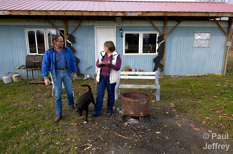 Fran Lynch in a United Methodist deaconess in Willow, Alaska, involved in a variety of ministries with people in the region. Here she talks with Robert Sisson outside his home. She delivers food to the man.