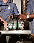 June 18, 2013. Chapel Hill, North Carolina<br />  Head distiller George Dusek, left, and Simon Hinson fill and cork bottles of TOPO Gin.<br />  TOPO, Top of the Hill Distillery, the brainchild of owner Scott Maitland and Spirit Guide Esteban McMahan, is located in the old N&amp;O Building on Franklin Street. Making gin, vodka and American whiskey from locally sourced wheat, they are one of the few distilleries bringing  organic liquor to ABC shelves around the state.