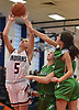 Grace Gately #5 of Manhasset, left, puts up a contested shot during a non-league girls basketball game against Farmingdale at Manhasset High School on Saturday, Dec. 8, 2018. Manhasset won by a score of 50-33.