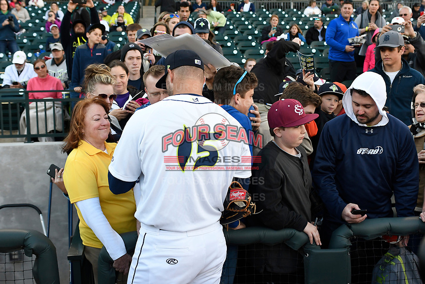 Left fielder Tim Tebow (15) of the Columbia Fireflies signs autographs before his his first Class A game against the Augusta GreenJackets on Opening Day, Thursday, April 6, 2017, at Spirit Communications Park in Columbia, South Carolina. (Tom Priddy/Four Seam Images)
