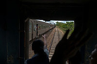 HAVANA, CUBA - APRIL 5: Cuban passengers wave to another train during a trip from La Havana to Santiago de Cuba on April 5, 2018.. in Cuba. Ferrocarriles de Cuba, is one of the oldest railroad around world, having opened its first route in 1837 with at least 17-mile long. Now the railway probably could cover more than 2,600 miles along the Island. (Photo by Eliana Aponte/VIEWpress)