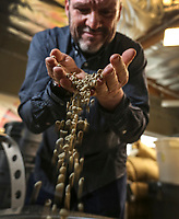 March 20, 2019. San Diego, CA. USA|  Owner of Bird Rock Coffee Roasters Jeff Taylor shows off some of his green coffee. | Photos by Jamie Scott Lytle. Copyright.