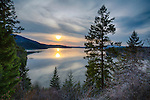 Idaho, Northern, Kootenai County, Hayden. Hayden Lake under hazy evening skies in spring.