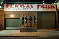 "A statue entitled ""Teammates"" by Antonio Tobias Mendez featuring the likenesses Ted Williams, Johnny Pesky, Bobby Doerr and Dom DiMaggio, stands outside of Gate B at Fenway Park in Boston, Massachusetts, USA, on the night before the 2011 season opener of the Boston Red Sox."