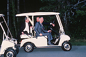 United States Secretary of State James A. Baker III, center, and Foreign Minister Eduard Shevardnaze of the Union of Soviet Socialist Republics, right, ride in a golf cart following the summit between President Mikhail Gorbachev of the U.S.S.R. and U.S. President George H.W. Bush at Camp David, the Presidential retreat near Thurmont, Maryland on June 2, 1990.  At left is an unidentified interpreter. Shevardnadze passed away on July 7, 2014 at age 86.<br /> Credit: Ron Sachs / CNP