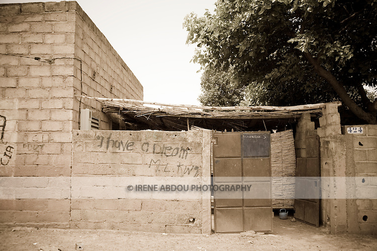 "The wall of a compound in Ouagadougou, Burkina Faso, bears Martin Luther King's, ""I Have a Dream."""