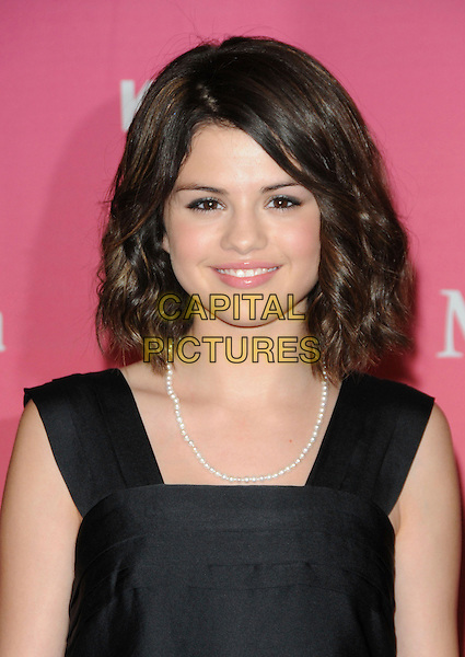 SELENA GOMEZ .at The Women in Film 2009 Crystal .and Lucy Awards held at The Hyatt Regency Century Plaza in Century City, California, USA, June 12th 2009                                                                     .portrait headshot black tiered layered white beads necklace .CAP/DVS.©Debbie VanStory/RockinExposures/Capital Pictures