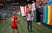 Portland, Oregon - Sunday September 4, 2016: Portland Thorns FC midfielder Allie Long (10) talks to team owner Merritt Paulson and his daughter after the win during a regular season National Women's Soccer League (NWSL) match at Providence Park.