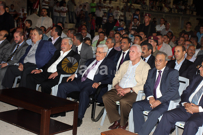 Palestinian President Mahmoud Abbas attends a mass wedding for 19 Groom in the village of Silwad in the West Bank city of Ramallah, June 28, 2012. Photo by Issam Rimawi