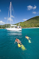 Katie Day and Malinda Oats snorkeling around sailing vessel Phaedrus at Honeymoon beach, St. John, USVI