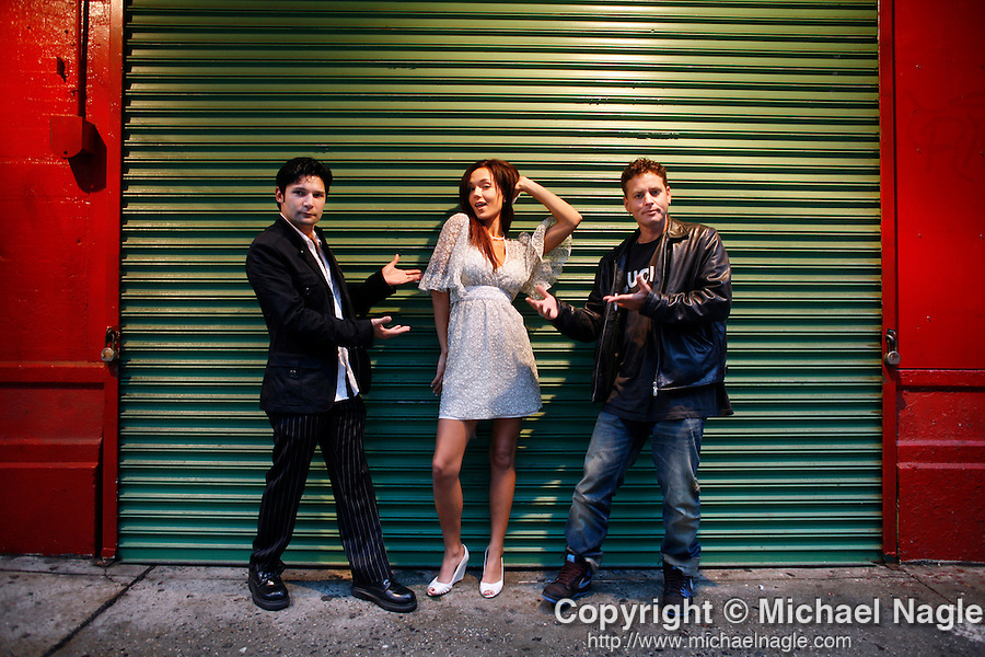 NEW YORK - JULY 23:   Corey Feldman (L) and his wife Suzie pose for a portrait with Corey Haim (R)  on Mulberry Street on July 23, 2007 in New York City's Little Italy.  They have a new reality tv show-- 'The Two Coreys.'  (Photo by Michael Nagle)