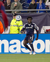 New England Revolution forward Kenny Mansally (7) passes the ball. In a Major League Soccer (MLS) match, Real Salt Lake defeated the New England Revolution, 2-0, at Gillette Stadium on April 9, 2011.