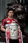 International rugby player Ayumu Goromaru of Japan from the Top 5 nations competing in this year's HSBC Asian 5 Nations poses with the tournament trophy near the iconic HSBC lion on January 19, 2011 in Hong Kong, China. Japan is the defending champions. Photo by Victor Fraile