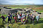 Hundreds of walkers donned their hiking boots and headed to the hills around Mount Brandon in West Kerry for the Dingle Walking Festival over the weekend. Our photograph shows the walkers heading off from Reask Monastic Site on Sunday..Picture by Don MacMonagle