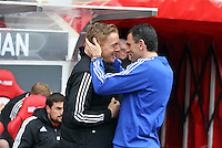 Pictured L-R: Swansea manager Garry Monk greeted by Sunderland manager Gus Poyet. Sunday 11 May 2014<br /> Re: Barclay's Premier League, Sunderland v Swansea City FC at the Stadium of Light, Sunderland, UK.