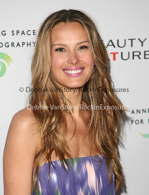 Petra Nemcova at The opening of BEAUTY CULTURE, a photographic exploration of how feminine beauty is defined, challenged and revered in modern society held at Annenberg Space for Photography in Century City, California on May 19,2011                                                                               © 2011 Hollywood Press Agency