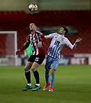 Paul Coutts of Sheffield United and Ruben Lameiras of Coventry City in action during the English League One match at the Bramall Lane Stadium, Sheffield. Picture date: April 5th, 2017. Pic credit should read: Jamie Tyerman/Sportimage