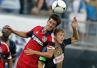 CHESTER, PA - AUGUST 12, 2012:  Brian Carroll (7) of the Philadelphia Union loses a header to  Alvaro Fernandez(4) of the Chicago Fire during an MLS match at PPL Park, in Chester, PA on August 12. Fire won 3-1.