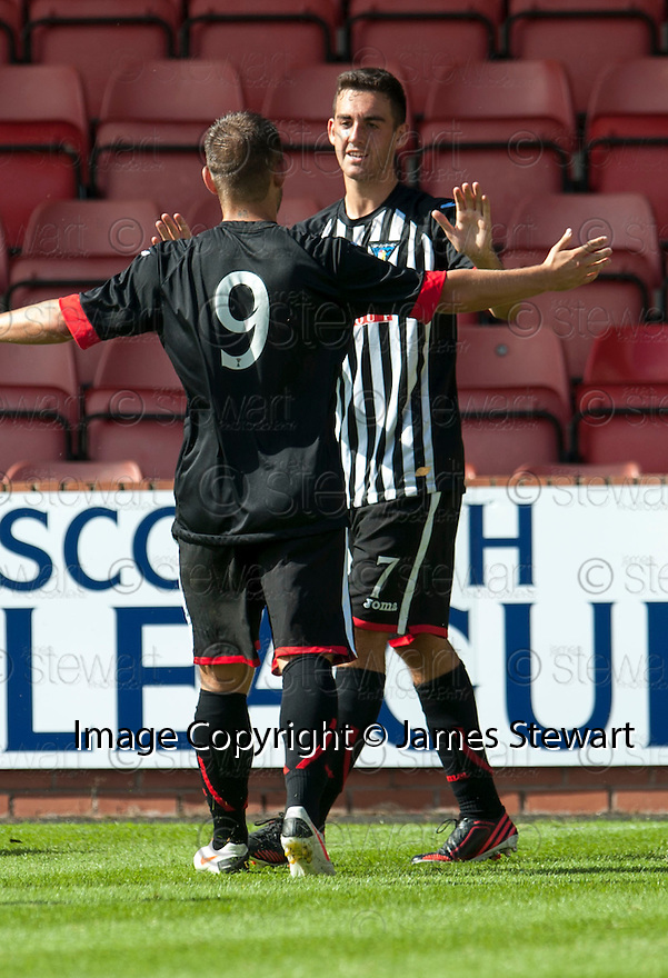 Pars' Shaun Byrne celebrates with Ryan Wallace after he scores their second goal.