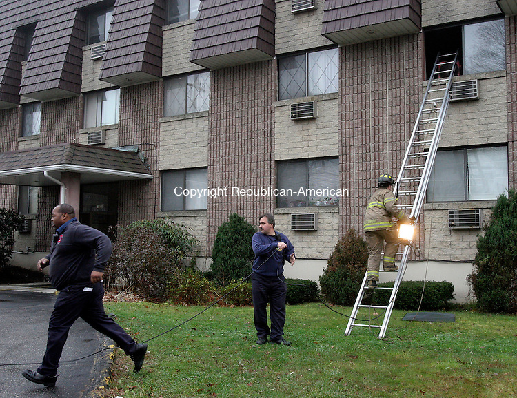 WATERBURY, CT-29November 2006-112906TK08- On Wednesday morning, Waterbury firefighters responded to a kitchen fire at Cheshire Crossing Apartments at 3250 East Main Street. Tom Kabelka Republican-American (Cheshire Crossing Apartments)